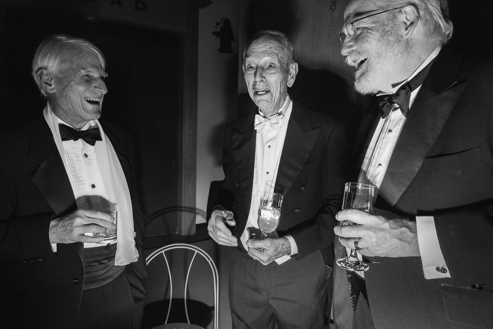 Carl Nash, Robert Hanson, and Dixson Butler, a science advisor to NASA, enjoy a joke about how long they've been attending the event.