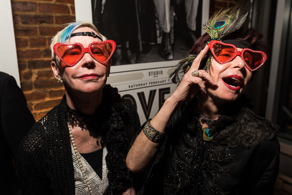 Artists Betsy Stewart and Annette Polan (from left) get theatrical with some flamboyant sunglasses.