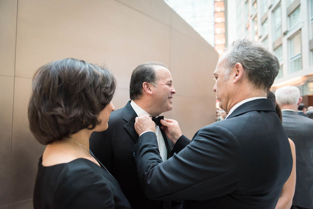 Former Mexican Ambassador and Gala Co-Chair  Arturo Sarukhan adjusts Panamanian Ambassador Emanuel Gonzalez-Revilla's bowtie at the Washington Performing Arts Gala on May 2 as his wife Luciana Conzalez-Revila looks on.