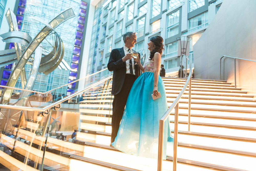 Mike and Sunghee Thomson cheers on the dramatic stairs at the Marriott Marquis.