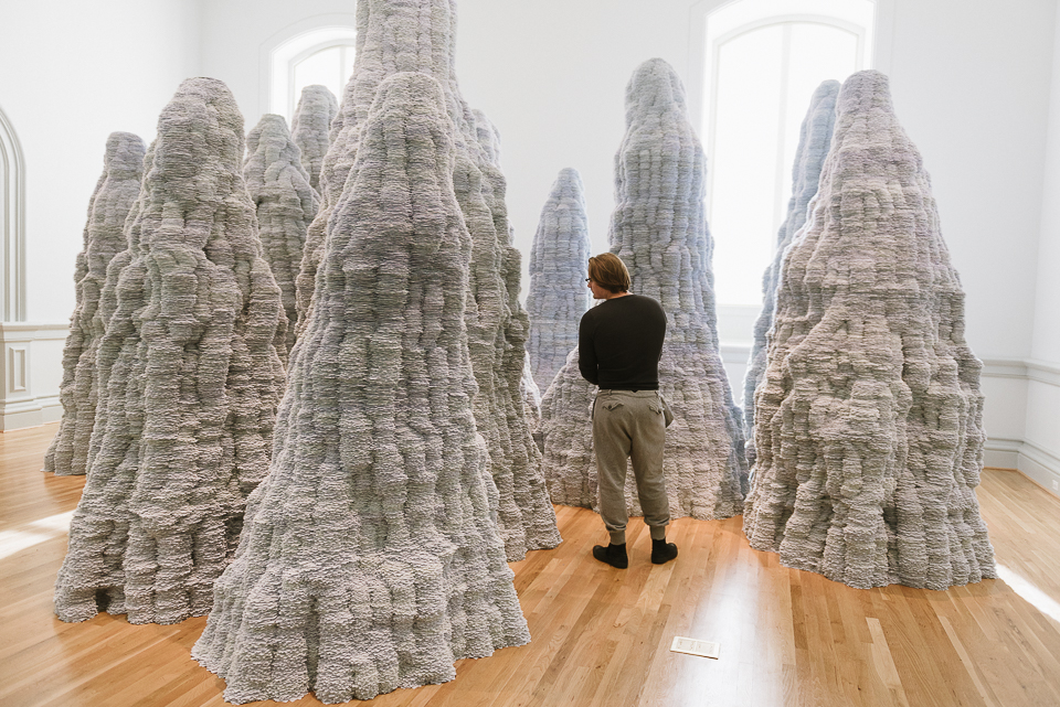 Martin stands among Tara Donovan's installation made of index cards.