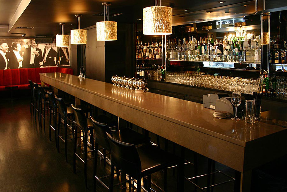 Bar Banquettes, Cocktail Tables at Paramount Hotel by Sentient Furniture