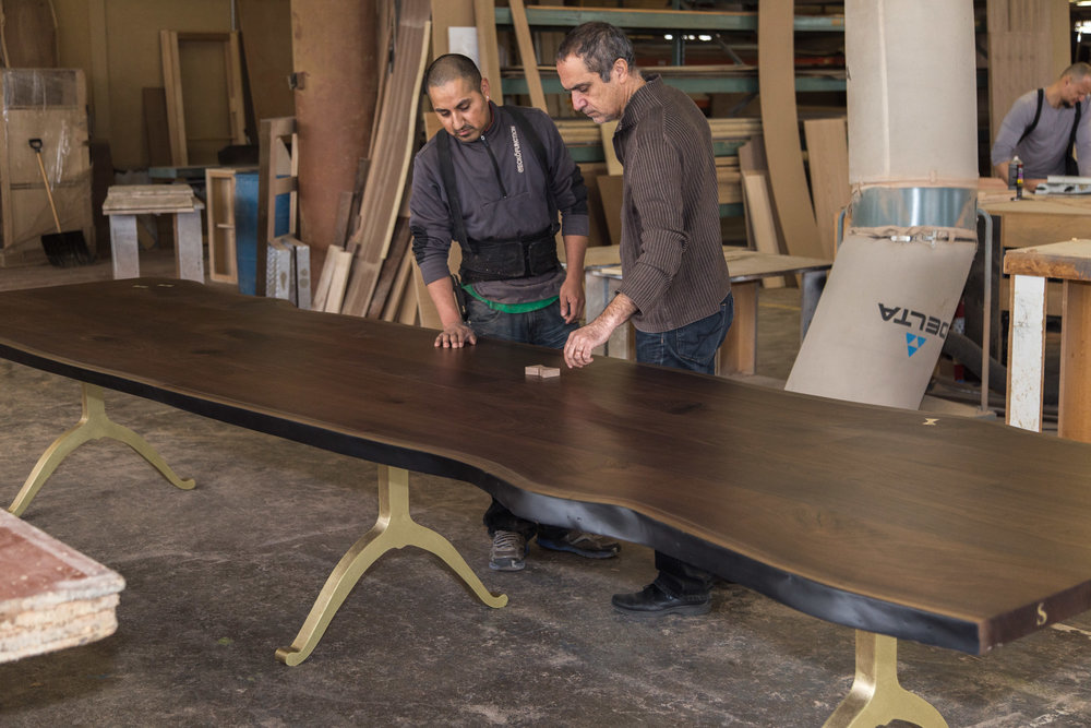 Brooklyn Workshop building Live Edge Slab Dining Tables from American Walnut