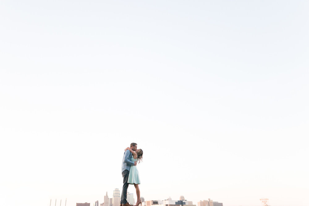 Kansas City Skyline Creative Engagement Portraits Wedding Photographer