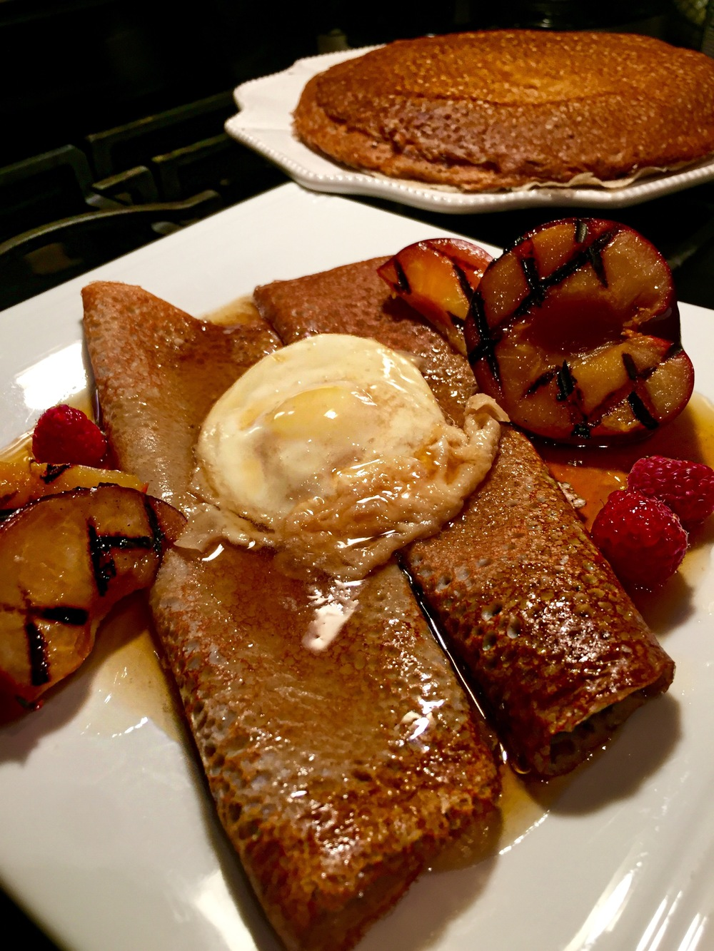 Buckwheat Crêpes with Maple Syrup Poached Egg and Grilled Plum