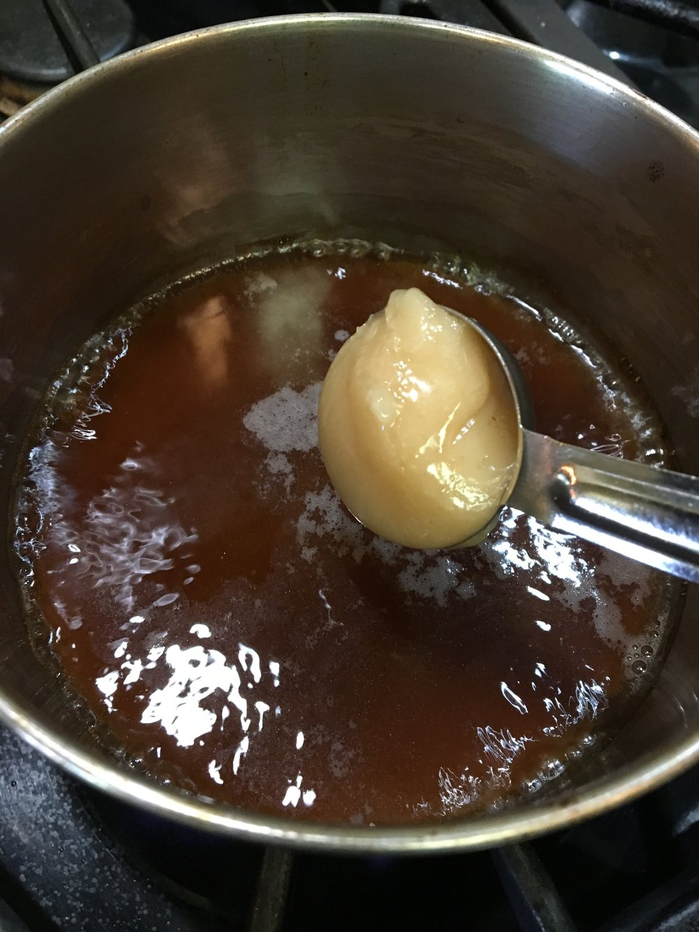 Adding Creamed Honey to the sauce