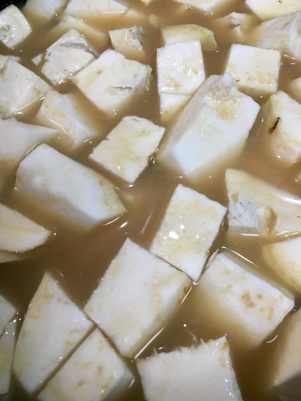 Cover the celeriac with stock.