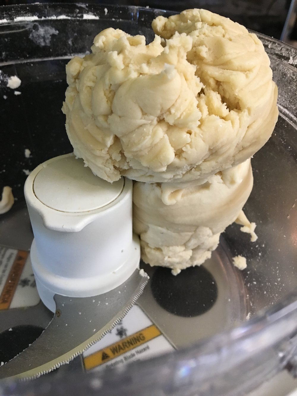 After the ice water is added and with the processor running, let the dough form into a ball on its own.