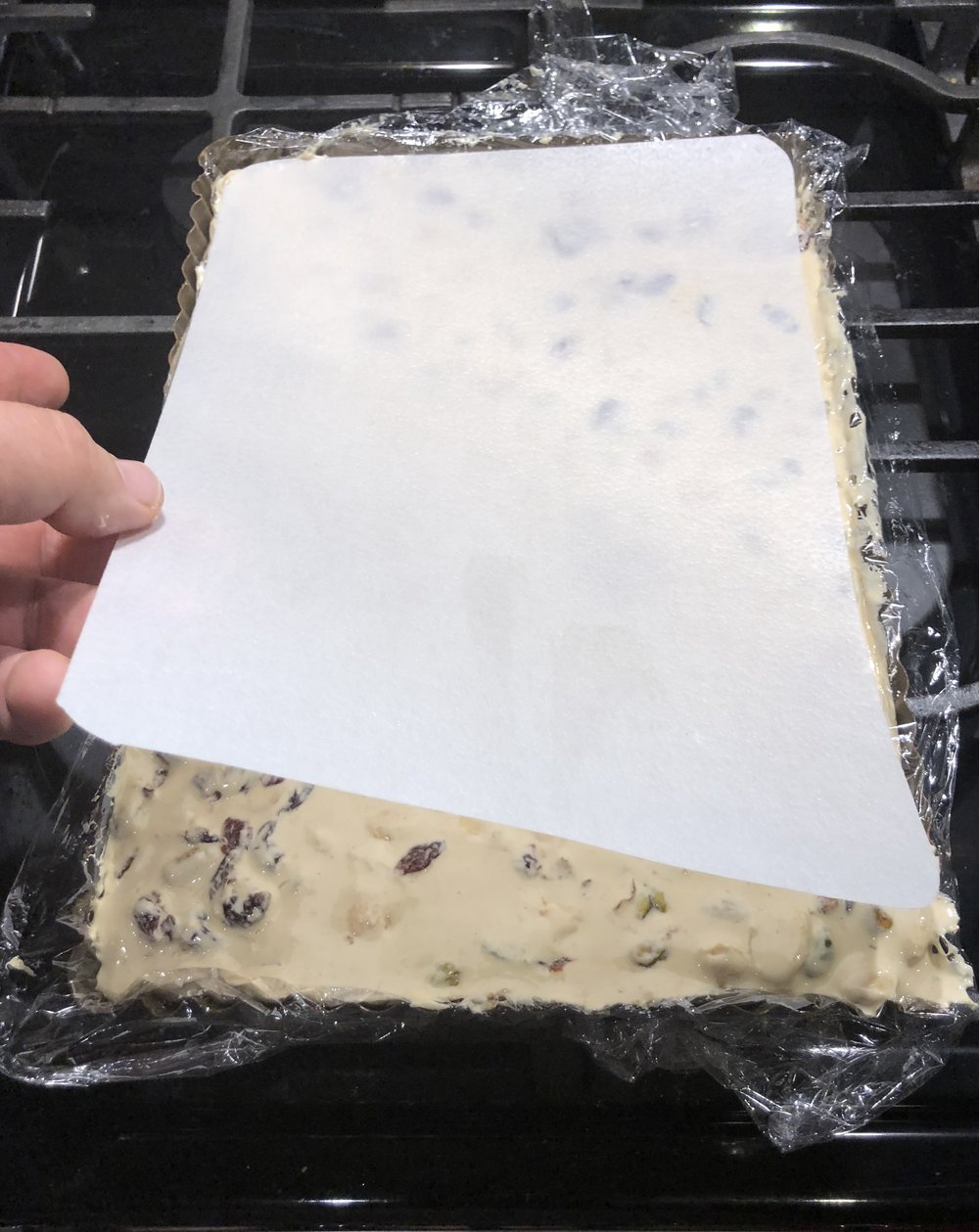 After pressing the torrone into your prepared pan, top off with the second sheet of wafer paper.