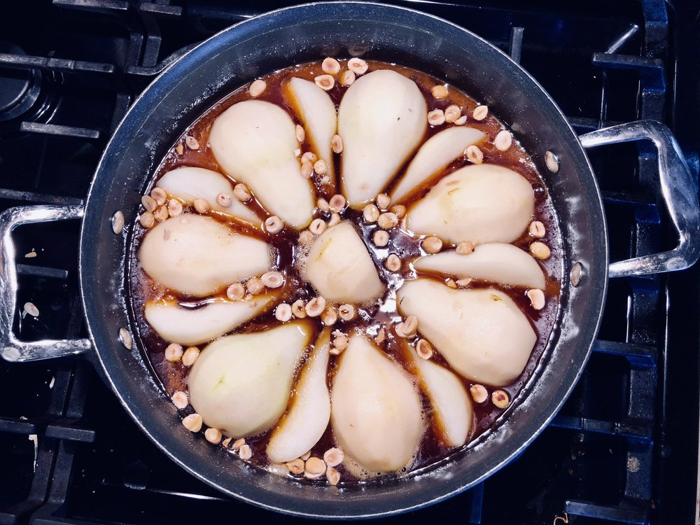 Caramel made, pears laid, and hazelnuts tossed in… time for the puff pastry!