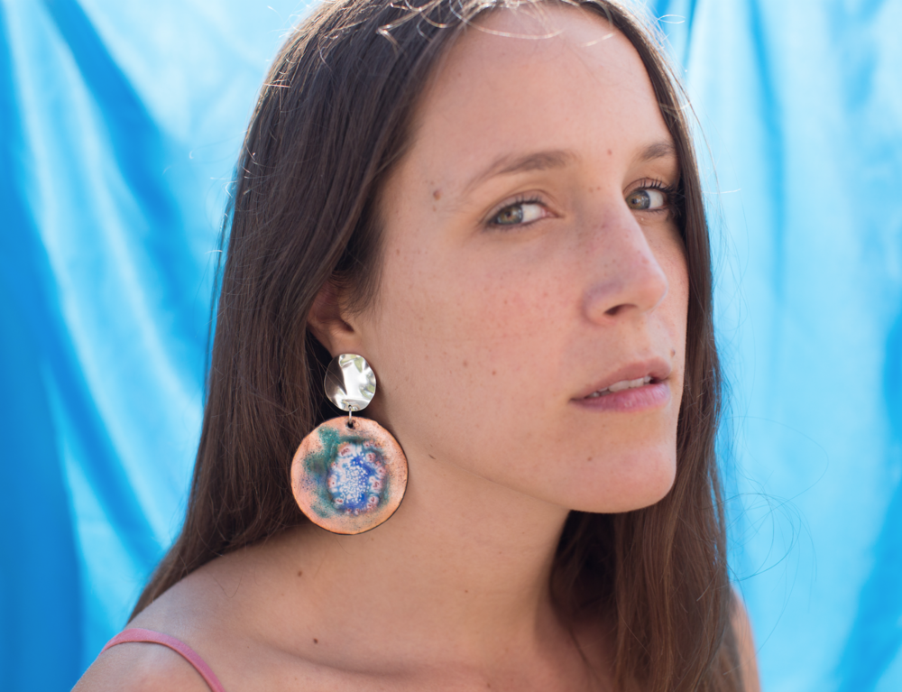 Zoe wears Stormy imaginary planet Earrings