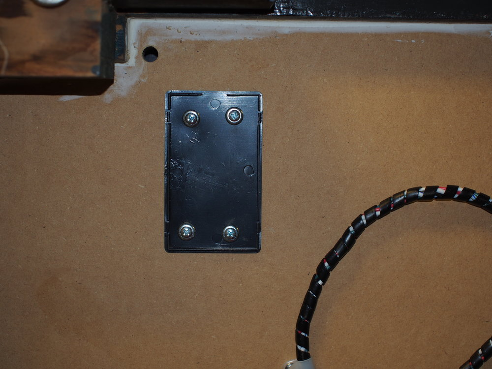 The case lid, along with the hole for the dial wires and the LED power leads