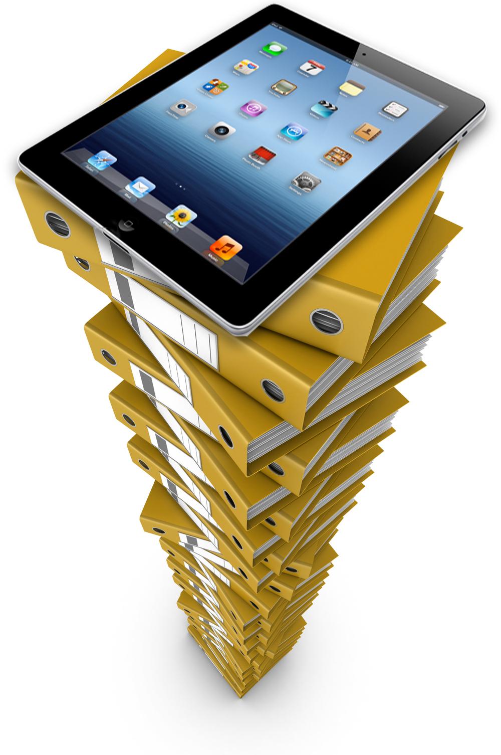 ipad-atop-stack-of-old-training-binders.jpg