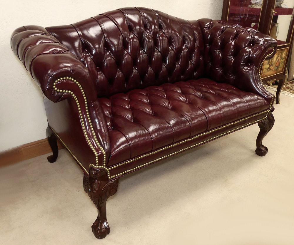 SOLD  Tufted Leather Chippendale Loveseat or Settee