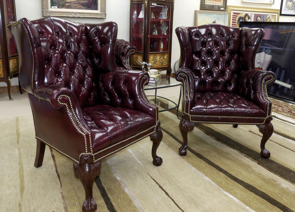 SOLD  Pair of Tufted Leather Chippendale Wing Chairs