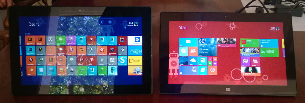 Our Surface Pro's crowded Start screen (left) vs. the nearly pristine Surface Pro 2's out of the box Start screen. I chose a red background to help tell them apart.