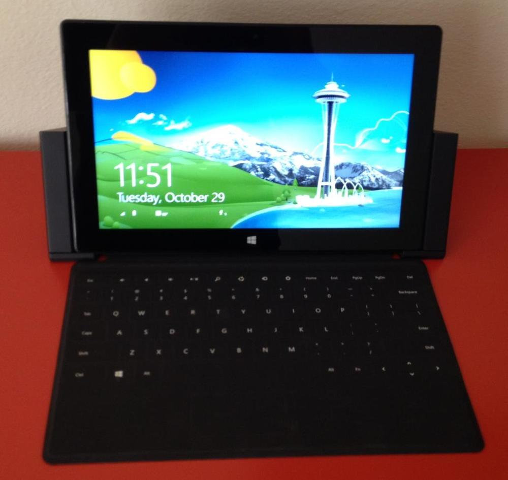The dock can be opened and closed with the keyboard covers in place. And better still, the keyboard cover can be attached or detached while the Surface Pro is docked.