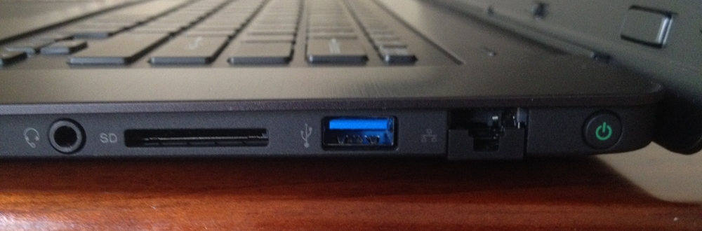The right side of the keyboard has a headphone jack, SD slot, USB 3 port, Ethernet and power button.