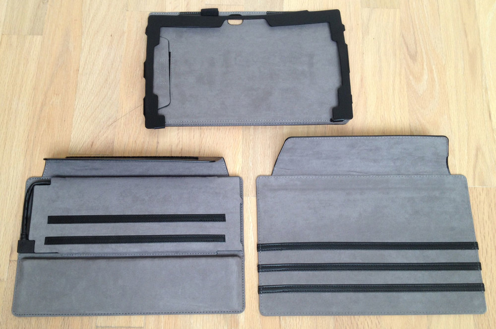 The ProKASE consists of three parts: the frame (above) holds the Surface Pro and has appropriate openings for the camera and the tablet's various other buttons, ports and vents. The other two parts are the dock cover (lower left) and the thin cover. The black strips sewn into both covers provide stops which duplicate the functionality of the Surface Pro kickstand.