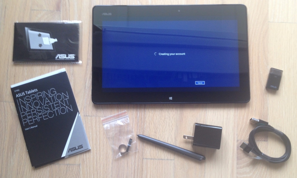 The Asus VivoTab TF810C pen is about the size of the Fujitsu T5000. It comes with five spare nibs and an extractor. There is also a cleaning cloth. The USB dock/power connector on the tablet is non-standard so it requires a USB dongle to connect peripherals.