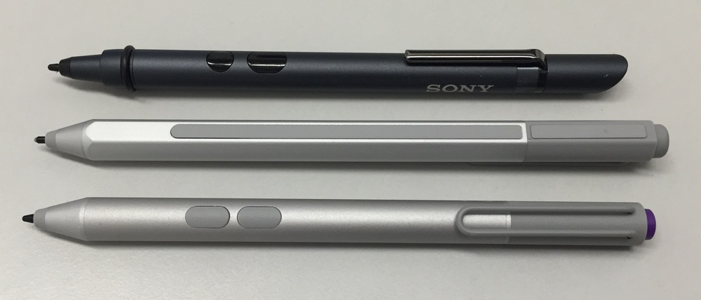 The Surface Pen (middle) is compatible with N-Trig DuoSense2 pens like the Sony Active Pen (top) and the Surface Pro 3 pen (bottom). The new pen has a single side button that is hidden under the tip end of the raised rubber strip located along the pen's flat edge.
