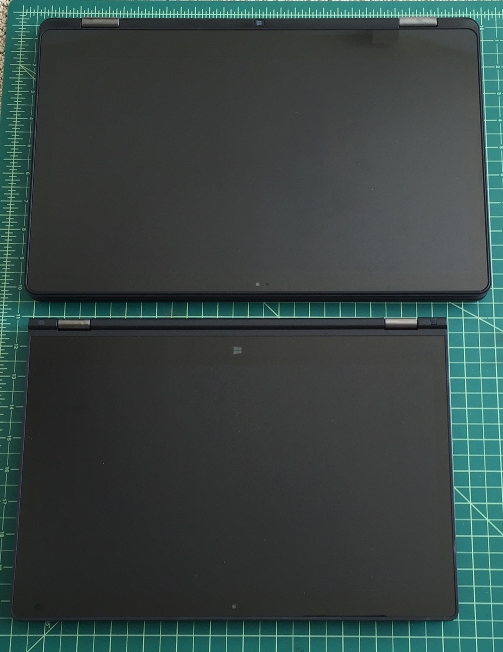 The seemingly insignificant 1.6 inch diagonal difference between the Dell Inspiron 15 (above, top) and the Lenovo Thinkpad Yoga 14 is a surprisingly big deal in practice.