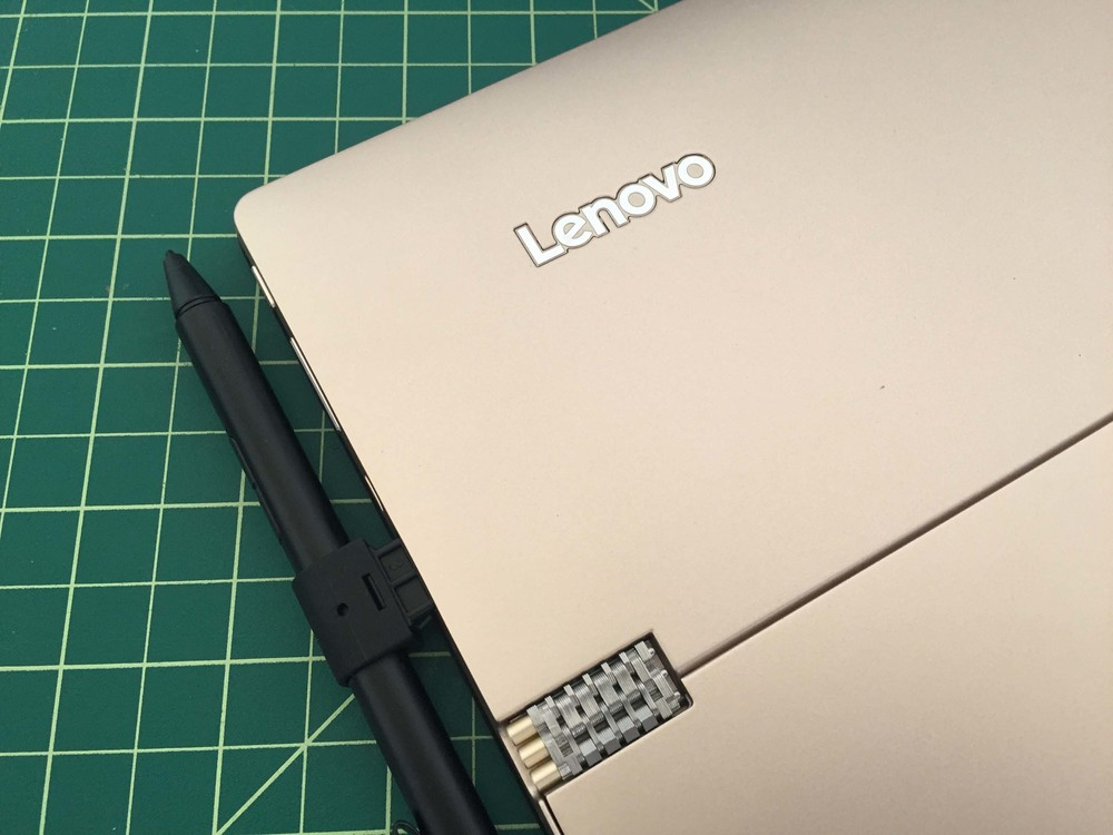 The pen holder plugs in to the USB port of the Ideapad Miix 700 or Yoga 900s, but it's not any different than the pen holder included with the Thinkpad Pen Pro