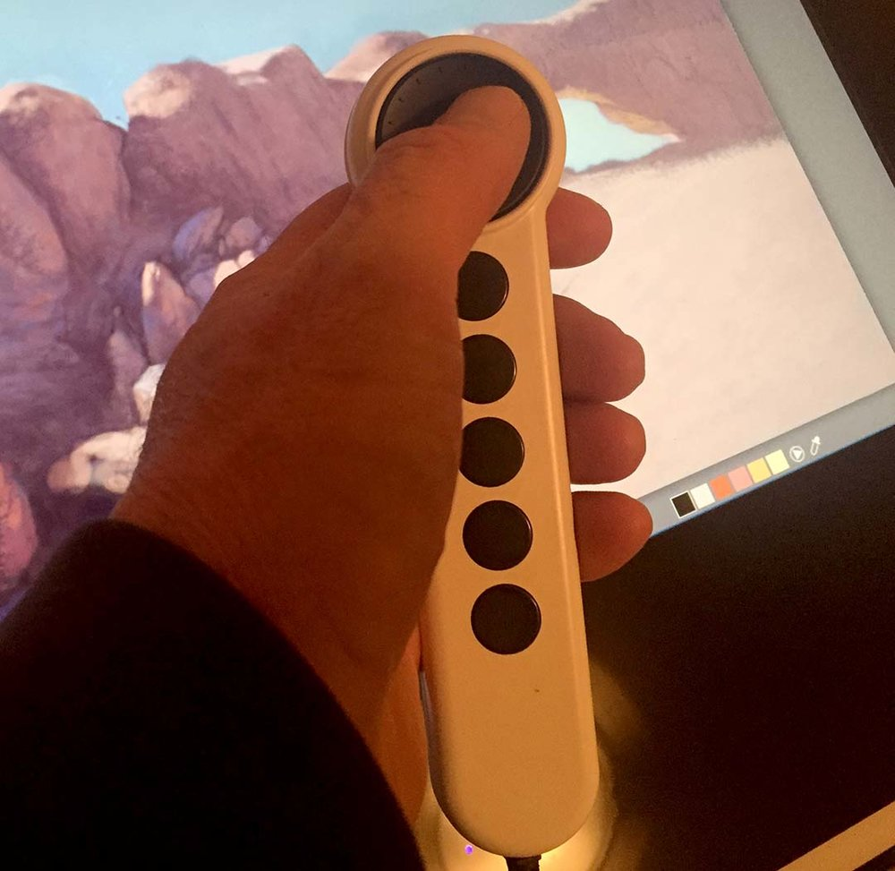 The remote wheel is cheap and toy-like, with suction cups arrayed on the back. But it works.