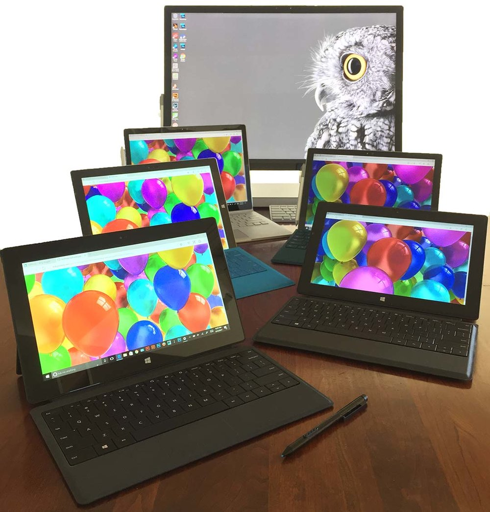 Four years of Surface: front to back, the original Surface Pro, the Surface Pro 2, Surface Pro 3, Surface Pro 4, Surface Book and the Surface Studio.