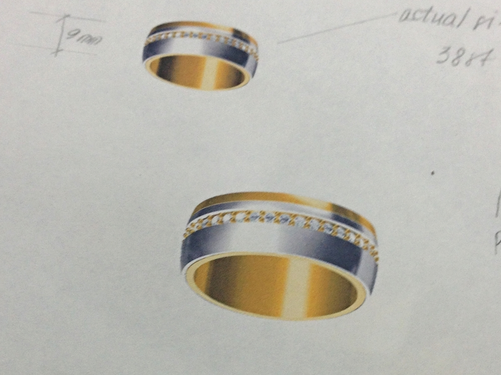 CAD rendering.  Groom's wedding band in platinum and 18k yellow gold mix, with diamonds all around.