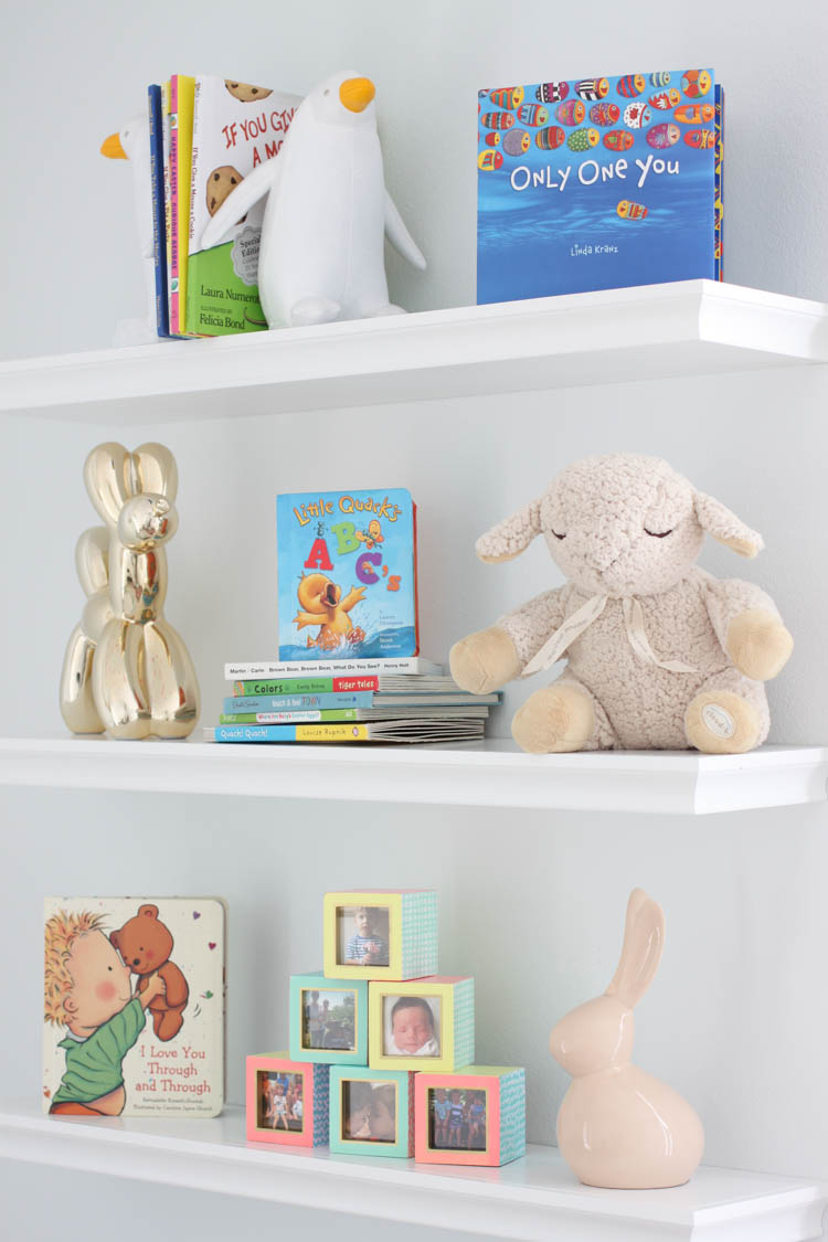 babyGirlNurseryWhiteWallBookShelves.jpg