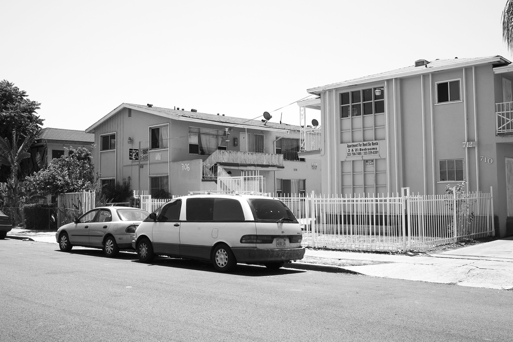 """Apartment for rent/ Se renta."" Apartment buildings off of Figueroa Street, South Los Angeles. 2009."