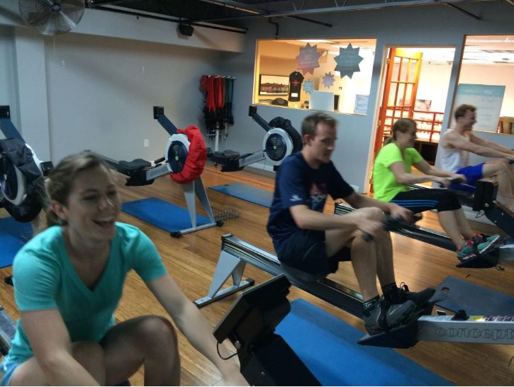 Eliza and Geoff of Adventure Is Out There bond over some rowing machines during Xplore Philly. The two teammates would eventually marry and now race together as husband and wife.