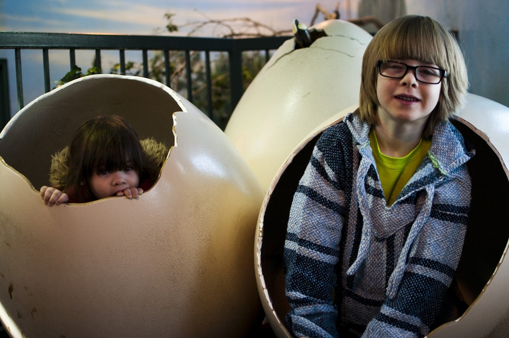 Eve & Luke hang out in a couple dinosaur eggs at the Kinsmen Discovery Center Aviary.
