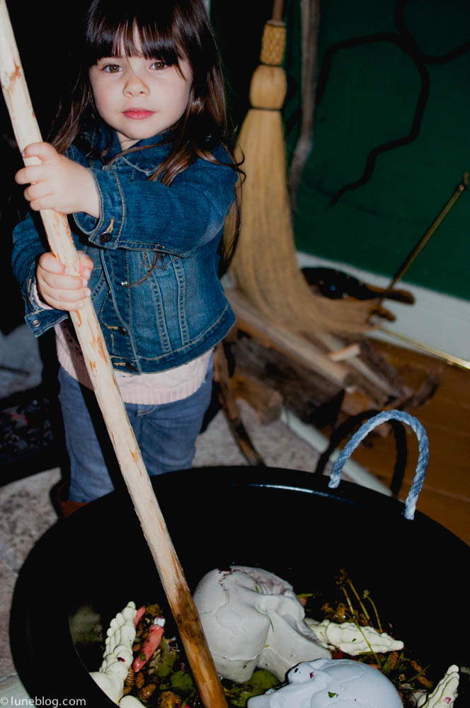 Eve taking her turn stirring the witches brew.