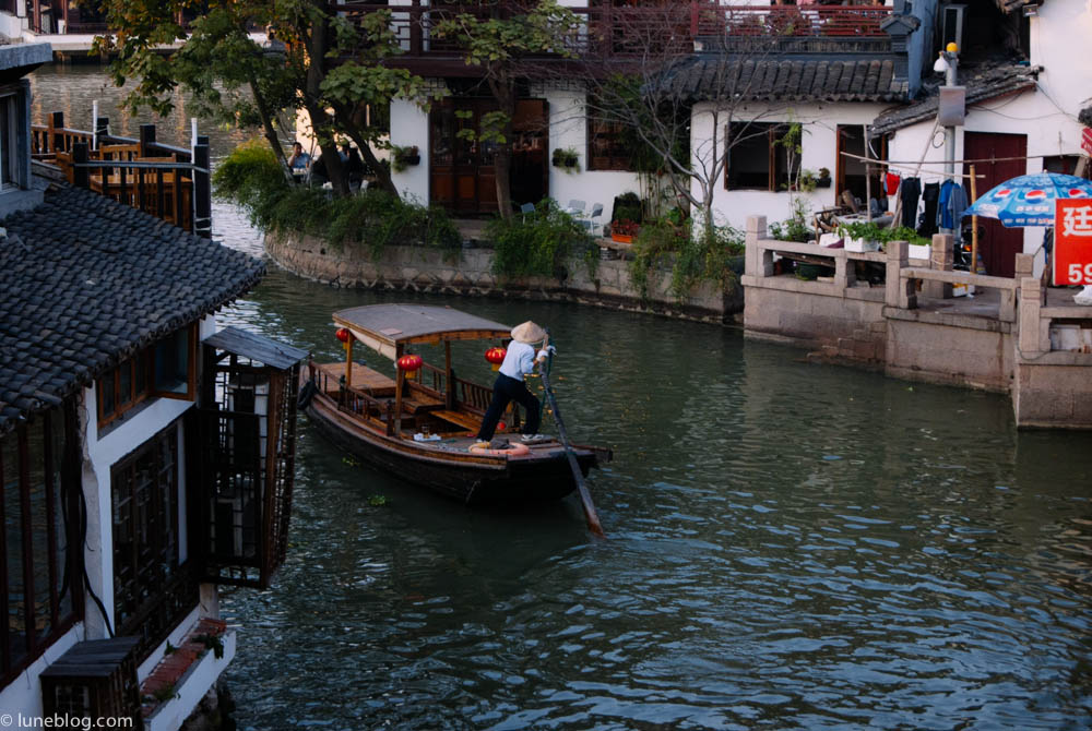 Local paddling the river through Watertown, outside Shanghai.