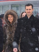 "Click photo to download. Caption: Syrian President Bashar al-Assad and his wife Asma in Moscow. Amid reports of Syria's chemical weapons arsenal falling within Hezbollah's reach, Assad reportedly remains ""calm,"" perhaps due to Russia's deployment of a sizable naval force for an exercise off the Syrian coast. Credit: Rakkar/Wikimedia Commons."