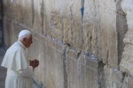 Click photo to download. Caption: Pope Benedict XVI prays at the Western Wall in Jerusalem's Old City on May 12, 2009. Credit: Nati Shohat/Flash90.