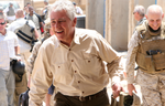 Click photo to download. Caption: Caption: Chuck Hagel in Iraq. Credit: Lance Cpl. Casey Jones.