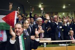 Click photo to download. Caption: Members of the Palestinian delegation at the United Nations General Assembly, including Palestinian Authority (PA) President Mahmoud Abbas, celebrate Nov. 29 upon the vote to upgrade Palestinian status to a non-member observer state at the UN. Arab-Israeli journalist Khaled Abu Toameh has been critical of Abbas and the PA, unlike his fellow Arab journalists. Credit: UN Photo/Rick Bajornas.