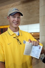 Click photo to download. Caption: Maccabi Tel Aviv's new shooting guard, Jon Scheyer, on Aug. 30 in Ben Gurion Airport with his new Teudat Oleh, given to new immigrants. Credit: Sasson Tiram. (Download additional photo here. Jon Scheyer with his luggage at Ben Gurion Airport. Credit: Sasson Tiram.)