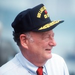 Click photo to download. Caption: Ed Koch, mayor of New York City, in 1988 sports a sailor's cap at the commissioning ceremony for the guided missile cruiser USS Lake Champlain. Credit: PH3 PATRICK J. CASHIN/Wikimedia Commons.