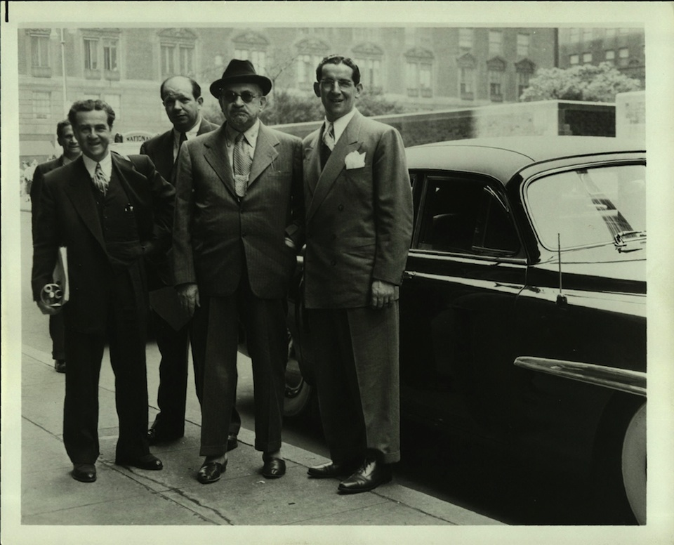 Dewey Stone (far left, newspaper under arm)with Chaim Weizmann (wearing hat), head of the World Zionist Organization and later the first president of Israel, in the 1940s. Credit: Chaim Weizmann Institute of Science.