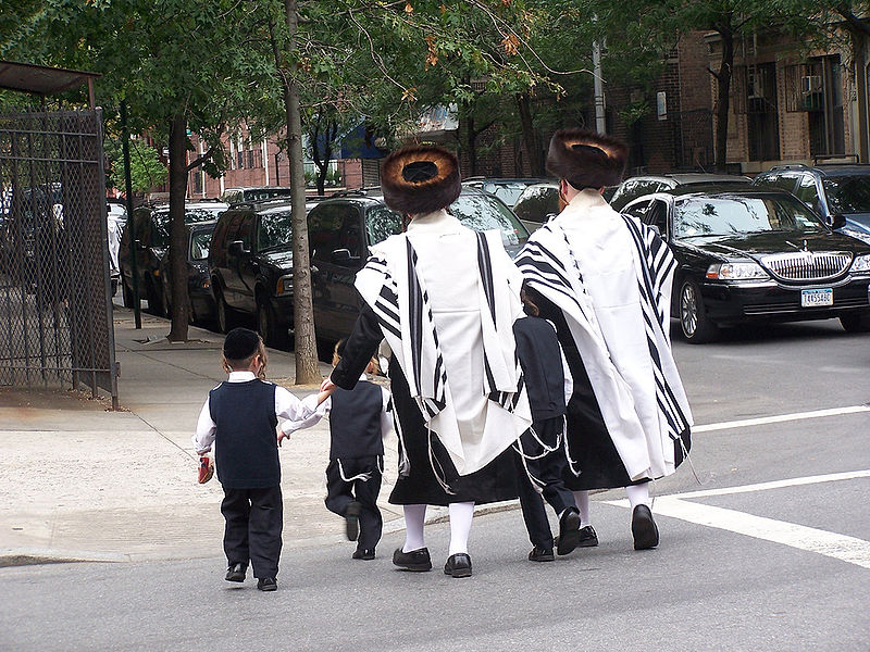 Ultra-orthodox Jews in Brooklyn. A couple from the Satmar Hasidic community was killed in a car crash Sunday. The woman's unborn baby was saved via C-section but later died. Credit: Wikimedia Commons.