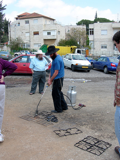 Koshering underway on a Jerusalem street. Credit: Judy Lash Balint.