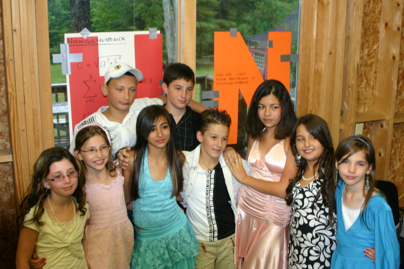 Click photo to download. Caption: Nine children from the southern Israeli city of Sderot who spent three weeks in 2007 at Camp Sunapee in Georges Mills, NH. Credit: Courtesy of Diana Burmistrovich.