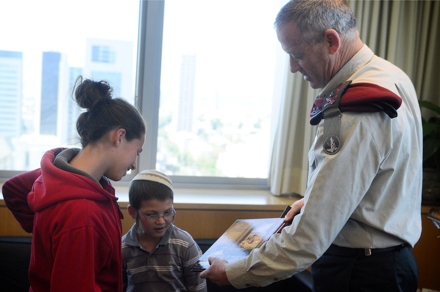 "Click photo to download. Caption: IDF Chief of Staff Lt. Benny Gantz meets with two surviving children of the Fogel family, whose parents and three siblings were murdered by Palestinian men in the March 2011 Itamar massacre. In a debate with J Street Executive Director Jeremy Ben-Ami on Monday, StandWithUs CEO Roz Rothstein noted that J Street specifically opposed a 2011 congressional letter asking President Barack Obama to urge the Palestinians to end anti-Israel incitement following the ""horrific, inhuman, and brutal attack in Itamar against the Fogel family."" Credit: Israel Defense Forces."