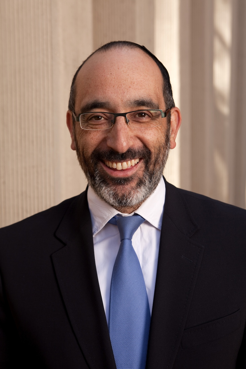 "Click photo to download. Caption: South African Chief Rabbi Warren Goldstein, who in an interview with JNS.org responds with historical context to the ""modern-day blood libel"" of Israel apartheid faced by the Jewish state. Credit: Office of Chief Rabbi Warren Goldstein."
