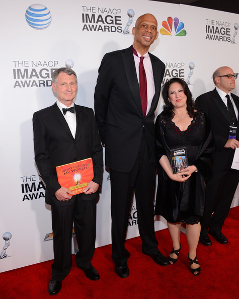 Click photo to download. Caption: Kareem Abdul-Jabbar (center) and his manager Deborah Morales (right) on the red carpet at the 2013 NAACP Image Awards. Credit:  Raymond Obstfeld.  .