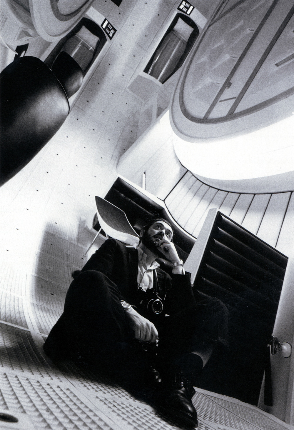 "Click photo to download. Caption: Stanley Kubrick inside the space ship ""Discovery"" on the set of ""2001: A Space Odyssey."" Credit: Warner Bros. Entertainment, Inc."
